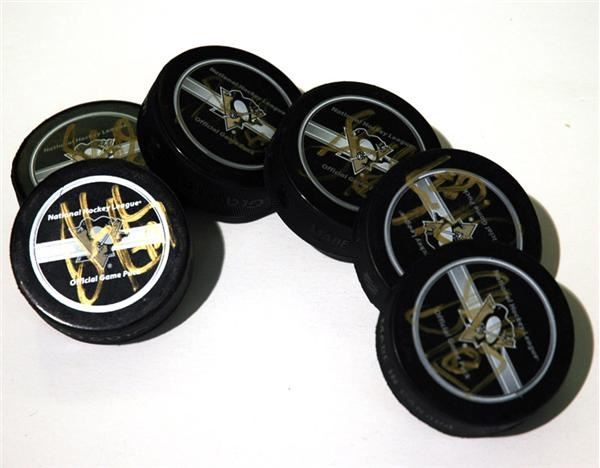 Six Sidney Crosby Signed Pucks From His Rookie Season of 2005-06