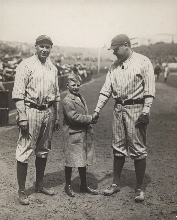 Babe Ruth Shakes Hand with Child (1920's)